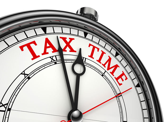 bigstock-Tax-Time-Concept-Clock-Closeup-29879213